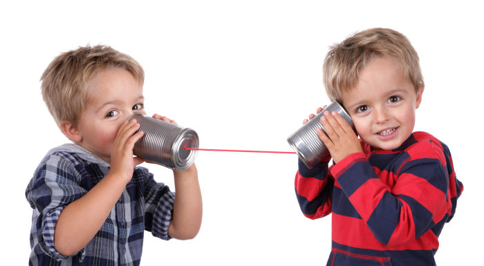 Two little boys with tin cans on a string